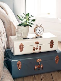Made from lightweight iron and coated in two stylish shades of dove grey and soft blush, our set of two different sized metal trunks have copper coloured detailing. With a subtly distressed finish, our trunks are a brilliant storage solution for bedding and towels, and can be stacked together for a unique bedside table. As seen in Ideal Home.