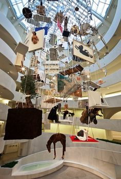 Maurizio Cattelan, All @ Guggenheim New York in 2011/2012    All, is a collection of work he has done since 1989–sculptures, works on paper, photographs and prints–that wisely uses the interior open space of the museum, hanging the pieces from the ceiling in an intricate weave.