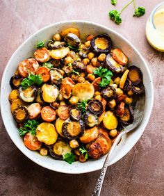 Turmeric Roasted Chickpea Rainbow Carrot Salad with Apple Cider Tahini Dressing. A nourishing vegan salad recipe with golden glow! Tasty plant based meal.