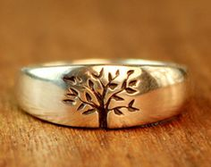 Relationships, like any living thing, have the tendency to grow and evolve with time. Two people embark upon a union that begins as a tender, green sapling and eventually becomes a solid, stoic tree with deep roots. The Tree of Life Wedding Ring symbolizes a relationship cultivated with love and thriving on commitment, looking forward to many years of the strength and joy that sustain life. ______________________ This ring will be made just for you and will ship in about 3 weeks. ________...