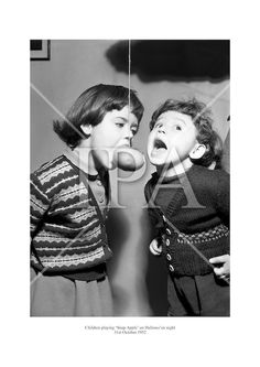 Children playing 'Snap Apple' on Hallowe'en night. October 1952 See more photos like this at www. Fine Art Photo, Photo Art, More Photos, Couple Photos, Play S, History Photos, Second Child, Halloween Night, Photo Archive