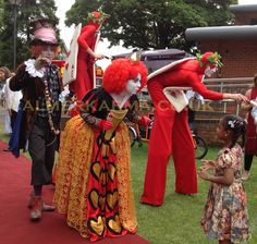 Alice in Wonderland Acts to hire worldwide - Red Card Stilts, Red Queen Lookalike and Mad Hatter lookalike. Perfect for family friendly events and corporate summer parties and festivals. Uk Parties, Summer Parties, Johnny Depp Mad Hatter, Stilt Costume, Captain Jack Sparrow, Alice In Wonderland Party, Red Queen, Through The Looking Glass, Party Entertainment