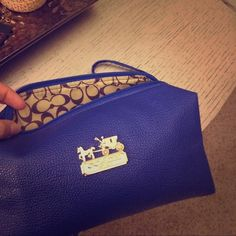 Coach makeup bag Brand new comes with strap ! Feel free to offer prices you think are reasonable. Bags Cosmetic Bags & Cases