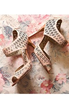 Lacy cutouts make this Sam Edelman sandal so charming...