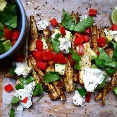 Homemade Parsnip Nachos. A deliciously healthy alternative! Find the recipe on my blog X #vegan #parsnip #nachos #baked #harissa #salsa #homemade #healthy #vegetable #vegetarian #glutenfree #dairyfree #recipe #theaccommodatingchef #fingerfood #dinner