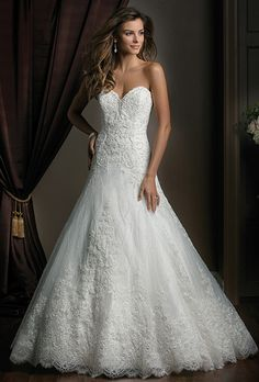 Jasmine Couture. A glamorous layer of Alencon Lace covers this dress from the strapless sweetheart neckline to the rich layers of the ball gown skirt. The intricate detail and design of the lace and beading set this dress apart from the rest and would make any bride glow on her special wedding day.
