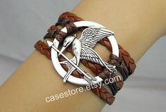 Mockingjay pin braceletgame brown leather by charmcover on Etsy, $7.99