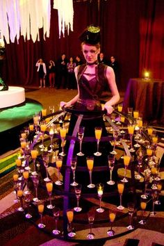A staffer dressed in a tiered metal skirt that held champagne cocktails roamed the room. Later on, during dessert, her skirt offered guests glasses of champagne-and-gold-leaf gelée with raspberry Bavarian cream and fresh raspberries.