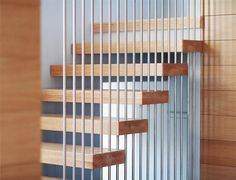 wheeler staircase: Stainless steel rods with oak treads