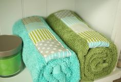 """Patch-work towel makeover: use the left-over fabric from the shade or shower curtain ot tie together the """"look"""" of your bathroom's new decor.  This great fabric """"stash-buster"""" was posted by Tasha Noel on """"A Little Sweetness""""."""