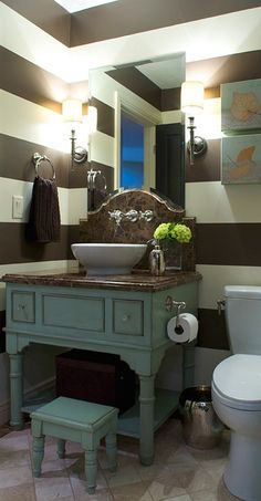 Teal and brown -- The striped walls are adorable! LOVE how they used kamode style dresser for sink