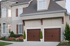 Amarr Dark Woodgrain Recessed Panel garage door with optional Blue Ridge Handles and Strap Hinges. Visit www.amarr.com for more great styles.