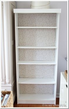 Wrap a piece of cardboard in fabric and put at back of bookcase instead of painting or wallpaper. You can change the backing to match your decor in any room. You can also change the backing for holidays.