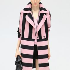 Amazingly Beautiful Pink and Black striped coat. Knee length, faux wool ( polyester and polycrylonitrile ) side pockets and mid section close snaps. Sizes M, L and XL Large is Available. Other sizes o