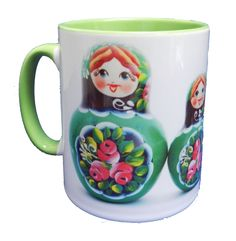 Green Russian Doll (Matryoshka) Ceramic Mug with a green glazed handle and inner, showing a set of 5 Russian (Matryoshka) Nesting Dolls resplendent in green. Designed and printed in Britain. A high quality ceramic mug which is dishwasher proof. Height is 9cm, diameter 8cm, with a capacity of 245 ml. From the Series 1 Original Line Range by Half a Donkey Ltd. www.halfadonkey.co.uk