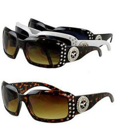 Rhinestone decorated sunglasses with star concho. UV400 Protection. Polycarbonate lens. Available in white, black, and tortoiseshell.
