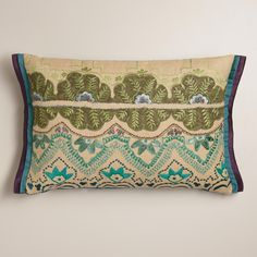 Appliqués with cool blue tones zig and zag while intricate green flowers bloom on our lumbar pillow. Featuring a double flange and dupioni on either end, this throw pillow gets all the details right.