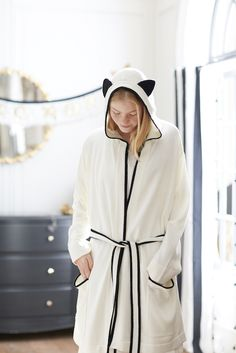 Meow! Who's ready for Cat-ruday? This plush robe brings whimsical fun to your bath routine. Black and white and with a cat-eared hood, it's full of playful personality. Designed exclusively for PBteen by celebrity stylists and fashion designers Emily Current and Meritt Elliott, it captures their classic and rebellious aesthetic.
