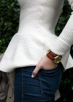 White peplum sweater.
