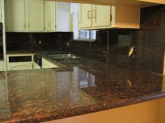 Tan Brown Granite Kitchen Countertop and Backsplash. I like the color but the backsplash is too much. ~ET
