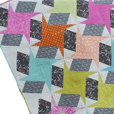 Quilts and More Magazine Spin Art quilt pattern by Sharon McConnell featuring Flow fabrics by Zen Chic for Moda