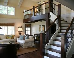 I've read staircases are expensive to build....but keeping the lower half along the wall would really open up the entry area/dining room...