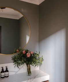 Fauvist Design Mel Winata - In creating a darker, relaxing mood in this tiny but sleek powder room, Perth-based designer used a vanity top in Calacatta Blanco, one of the 18 natural looking veined surfaces in the Smartstone quartz collection.
