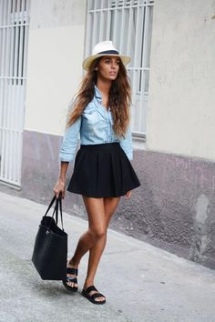 Spring Outfits 2015: 50 Flawless Looks to Copy Now - a chambray shirt tucked into a pleated mini skirt, worn with a brimmed hat + sporty patent leather slides