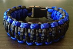 Electric Blue & Black WIDE XL paracord survival bracelet features a larger 5/8th inch buckle and lots of 550 MilSpec paracord in fact this bracelet has 2 feet for every inch! build yours at cncoutfitters.com