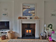 Bespoke MDF mantel with reclaimed brick slip chamber, natural slate tiled hearth and Charnwood Island 1 multi fuel stove fitted in Chalkwell Essex 2010