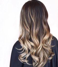 Long Layered Wavy Hair with High-Contrast Pearly Blonde Bayalage