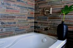 30 Bathroom Tiles You Will LOVE: Stunning Linear Copper Tile For Tub Surround