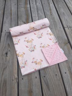This ultra soft and ultra cute baby blanket is made with premium 100% cotton from Hawthorne Threads Fawn collection and cuddly minky dot backing
