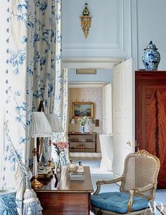 Mark Gillette - Architectural Digest A blue and white bedroom and a look into the blue and white landing, both punctuated with blue and...