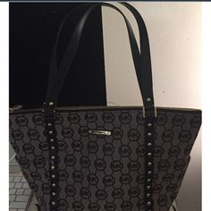 Michael Kors tote black fabric monogram michael kors bag, with authenticity card, used a few times still like new. I take good care of my bags, no stains nothing wrong with them. Michael Kors Bags Shoulder Bags