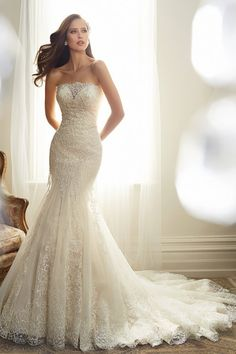 Wedding Gown Gallery | BridalGuide Sophia Tolli $1,501 - $3,000Style Y11574 Details Hem: Floor length Neckline: Strapless Silhouette: Fit-n-flare Sleeve Length: Sleeveless Train: Chapel Length Fabric: Lace Tulle Fit-and-flare tulle gown featuring a strapless neckline and semi-sheer modesty panel. A back corset and chapel-length train with matching scalloped hem lace are also offered.