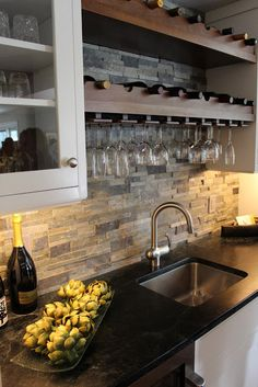 Stone backsplash and built in wine rack.