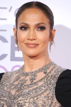 Who: Jennifer Lopez What: Smoked Honey Glam How: Glowing skin and tons of lashes are a Jennifer Lopez beauty staple. But at last night's People's Choice Awards, Lopez amplified her go-to look with the addition of dramatic black liner and a honey-toned glossy lip. Her makeup artist Mary Phillips used a combination of two liners to get a line that stark. The first was L'Oréal Paris Infallible Black Velvet liner, which she traced across both lashlines and ins...