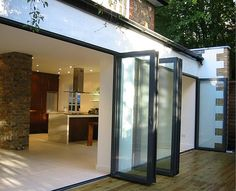These bifold doors would look fantastic in my kitchen. My current sliding glass door is boring and ugly. Bifold doors would also let in several times the amount of sunlight. I might even be able to save a few dollars on my heating bill. House Design, House, Home, Interior Barn Doors, Bifold Doors, Concertina Doors, Folding Patio Doors, Solid Interior Doors, Aluminium Doors