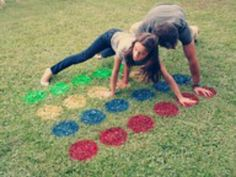 Backyard fun twister. Can use flour with food coloring instead of painting grass to make it temporary.