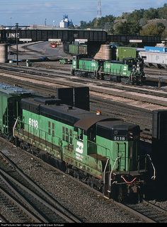 Common power at Northtown in the 1990s included SD9s and end cab switchers. Here a former GN SD9 works the south end of the yard while a pair of switchers rest near the Soo Line bridge. A few weeks prior to this shot the holding company BNSF was created to eventually merger BN and Santa Fe at the end of 1996.