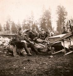 P/O John F Drummond (left) is seated with three sergeant pilots of No 46 Squadron RAF on kit bags and a parachute in front of an aircraft shelter at Bardufoss, Norway, in early June 1940. On 29 May 1940, whilst attacking a He 111 and hitting the starboard engine, Drummond was struck by return fire, causing his cockpit to fill with smoke. When turning back to base his engine failed, forcing him to bail out into Ofotfjord from where he was rescued by the destroyer HMS Firedrake.