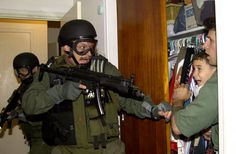 His picture, honored with a Pulitzer, showed Elian Gonzalez of Cuba being seized in a Miami home in 2000 amid an international custody fight.