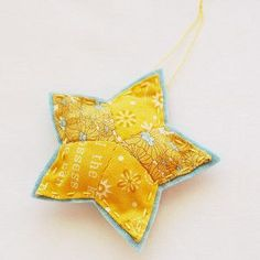 Want to make Christmas ornaments for your tree this year? No problem. This Shining Star Christmas Ornament is so basic and elegant. All you need to do is stitch five diamond shapes together.