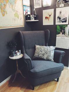 Strandmon Ikea chair in dark grey with grey walls