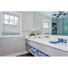 Envisioning a summery vibe, this bathroom establishes its décor with a bright palette of blues, whites, and grays. The dramatic statement provided by a nautical chandelier punctuates the pool house theme! Barn Lighting, Vintage Lighting, Chandelier Lighting, Cabana, Nautical Chandelier, Bathroom Wall Sconces, Light Bathroom, Barn Light Electric, Modern Interior