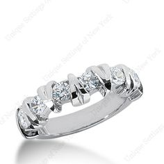Fabulous diamond wedding band in platinum .  Very different buy very cool.