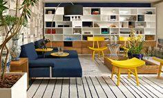 Azul e amarelo complementam-se como cores de maior destaque no ambiente, onde o profissional se apropria das linhas do tapete como elemento d...