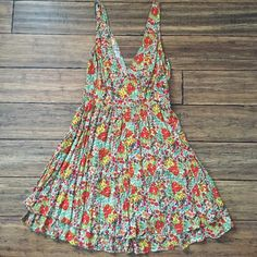"""Floral double V-neck dress Great floral dress with front and back v-necks. Only worn twice! Tired ruffle hem, back zip closure, measures 35"""" from shoulder to hem. Moda International Dresses Mini"""