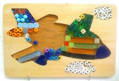 A creative way to recycle puzzle boards. Take out the remaining pieces (which can be used for woodworking), and made into a puzzle mosaic.